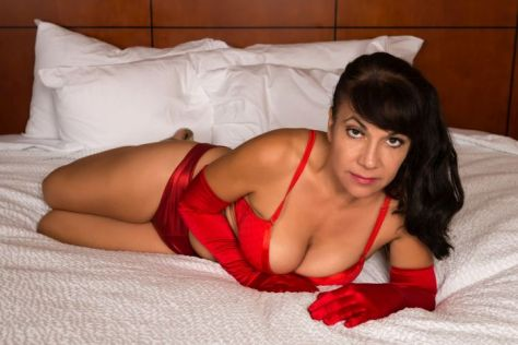 Pretty mature brunette in bright red lingerie and opera gloves