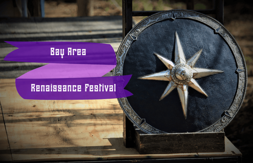 Text Bay Area Renaissance Festival reads over a shield with a starburst design