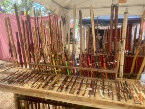 display of wooden walking sticks and magic wands