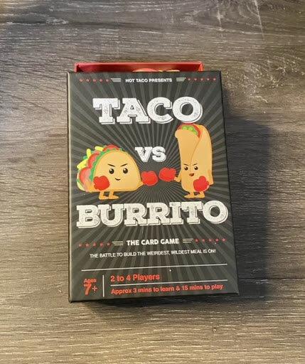Taco Vs Burrito Box Art Featuring a taco and burrito with boxing gloves