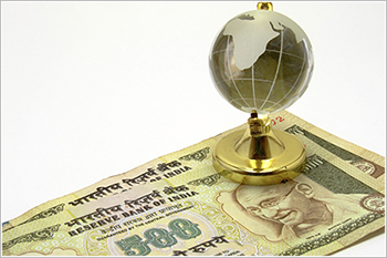 Indian currency and globe
