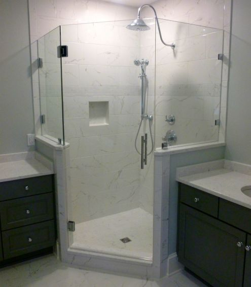 THIS NEO ANGLE 3 SIDED FRAMELESS SHOWER ENCLOSURE WAS INSTALLED WITHOUT A HEADER (  Metal across the top ) TO MAINTAIN THE CLEAN FRAMELESS LOOK.  BATH REMODEL BY LEO LANTZ CONSTRUCTION / GLEN ALLEN VA.  PROJECT WAS IN RICHMOND'S WEST END.