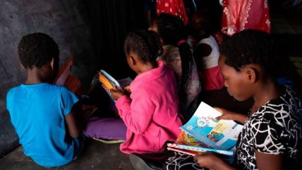 Displaced children from DRC, Rwanda, Burundi and other nations attend a makeshift school in a tent in a settlement for refugees in South Africa