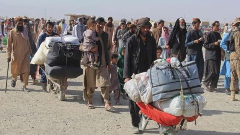 Afghans arrive at the Pakistan-Afghanistan border crossing at Chaman.