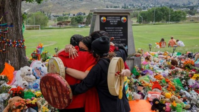 People gathering outside the former Kamloops Indian Residential School in British Columbia