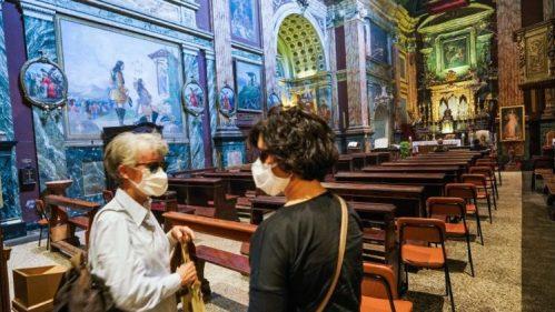 Faithful in a church in Torino, Italy
