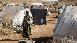 A lady is seen at a refugee camp housing Ethiopians fleeing the fighting in the Tigray region