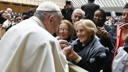 Pope Francis greets women