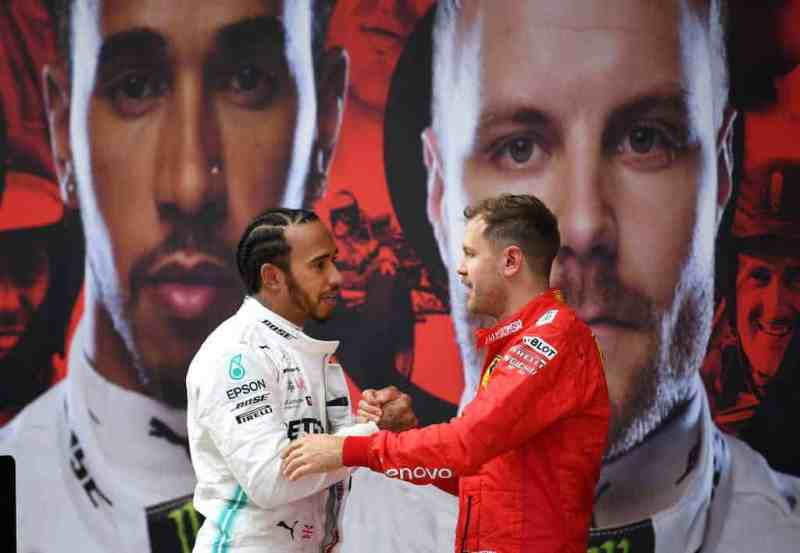Race winner Lewis Hamilton of Great Britain and Mercedes GP and third placed finisher Sebastian Vettel of Germany and Ferrari in parc ferme during the F1 Grand Prix of China