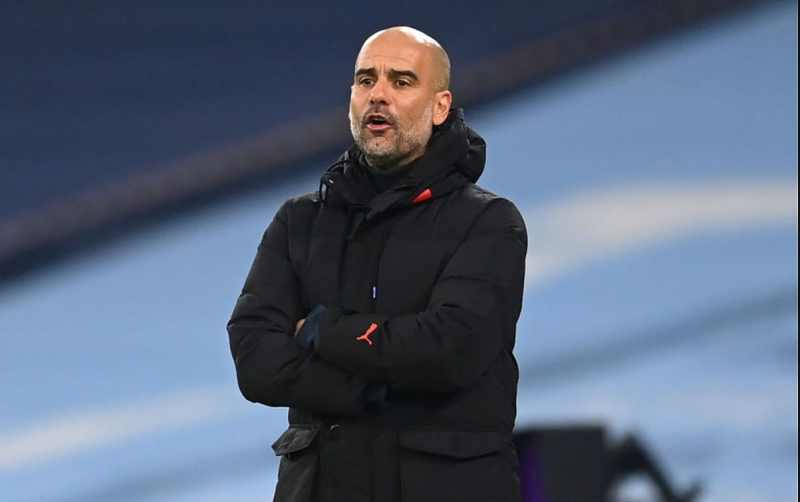 Pep Guardiola, Manager of Manchester City gives his team instructions during the Premier League match between Manchester City and Burnley