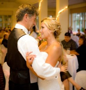 Crystal Janes-Russell with her father, Randal Craig Janes, at her wedding in August 2009 at River Ridge Golf Club banquet hall  in Oxnard.