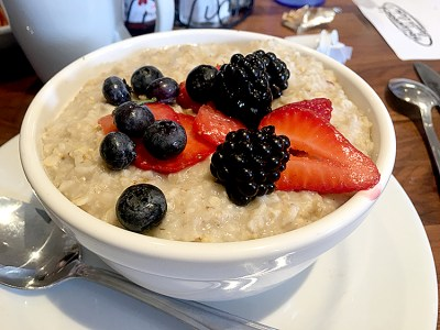Creamy porridge topped with fresh berries