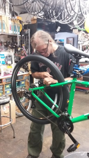 Owner David Knudson works on a bike.