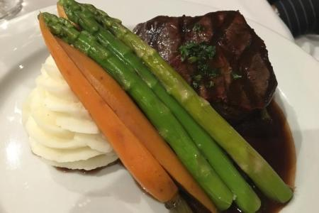 Thick cut steak, cooked medium and served with a very flavorful jus; on the side came grilled asparagus, whole carrots and creamy mashed potatoes