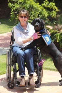 Melinda poses with her new service dog, Krista.