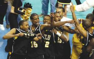 Walker (far left) celebrates with VCU teammates after the Rams downed Duke in the first round of the 2007 NCAA tournament.