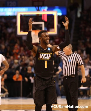 JeQuan Lewis celebrates after earning his first NCAA tournament win.
