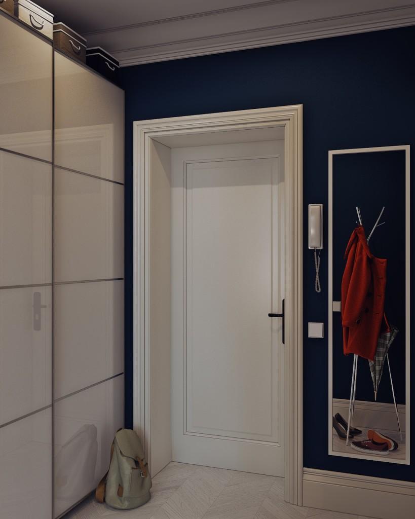 porta d'ingresso bianca con parete blu oltremare, armadi a muro con ante scorrevoli e specchio sulla destra