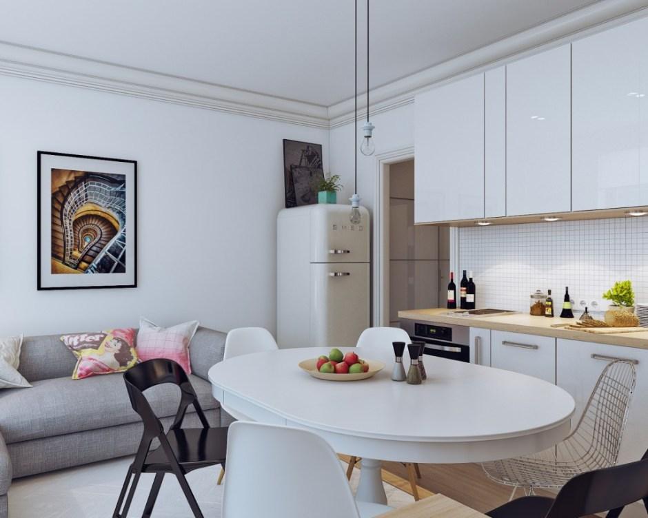 cucina bianca lucina con frigo smeg bianco, tavolo rotondo estensibile e divano grigio sul fondo