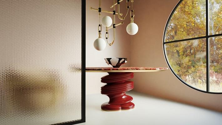tavolo con piano in marmo rosso, base in laccato opaco rosso e dettagli in acciaio oro