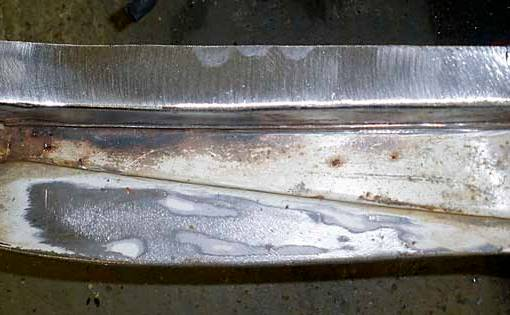 Final clean up and grinding flush of the welds to create invisible repair