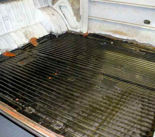 New complete cargo floor replacement panels get fitted in