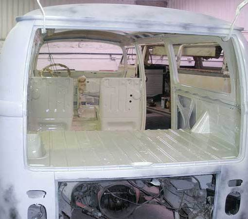 The inside of the camper gets sprayed L87 – Perl White