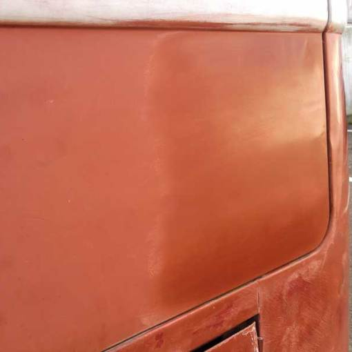 before and after – removing the over coat of red oxide primer
