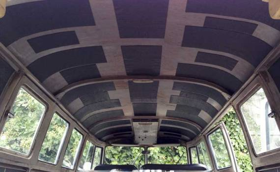 lining the metal roof with sound deadening panels