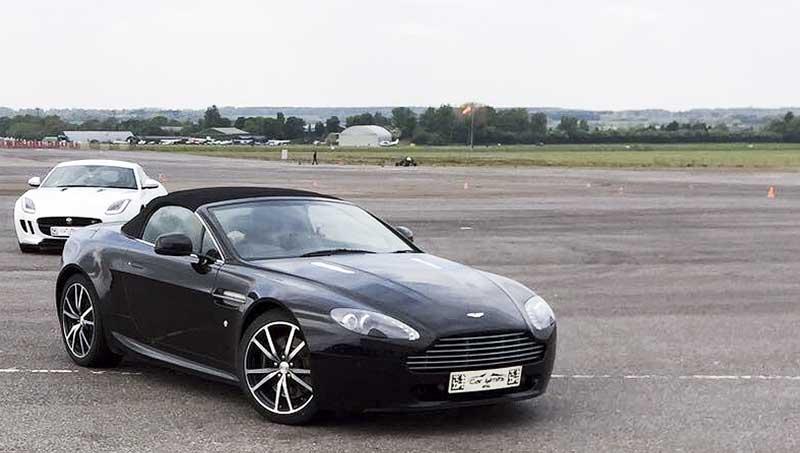 me behind the wheel of a 4.2 litre V8 Aston Martin Vantage convertible
