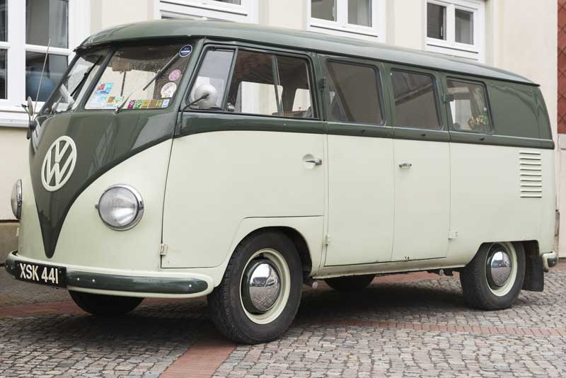 cake stop escape from the rain in a cool 1955 Palm Green/Sand Green bus