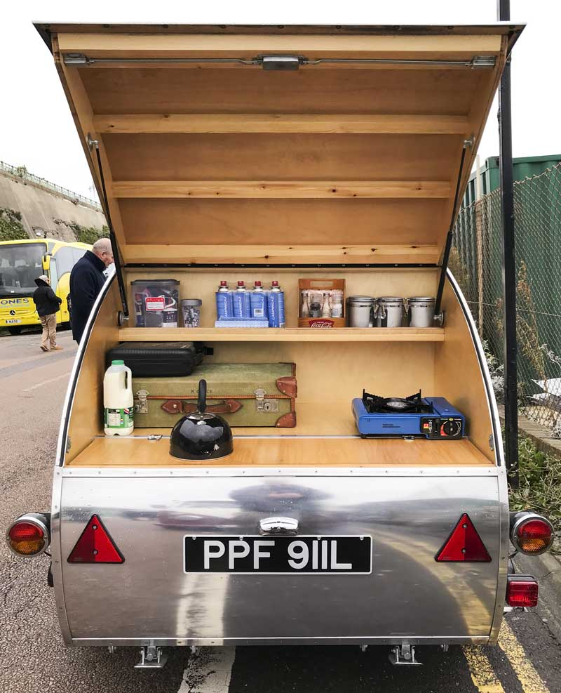 plenty of storage space in the back of this tiny retro designed teardrop caravan