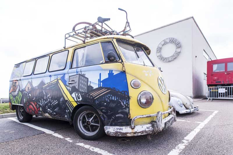 custom graffiti paint and windows in this converted panel van