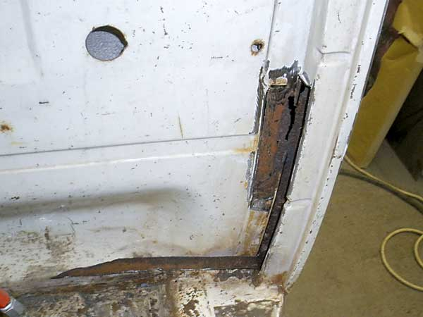 Small area of rust that needs to get repaired on the bulkhead pillar section