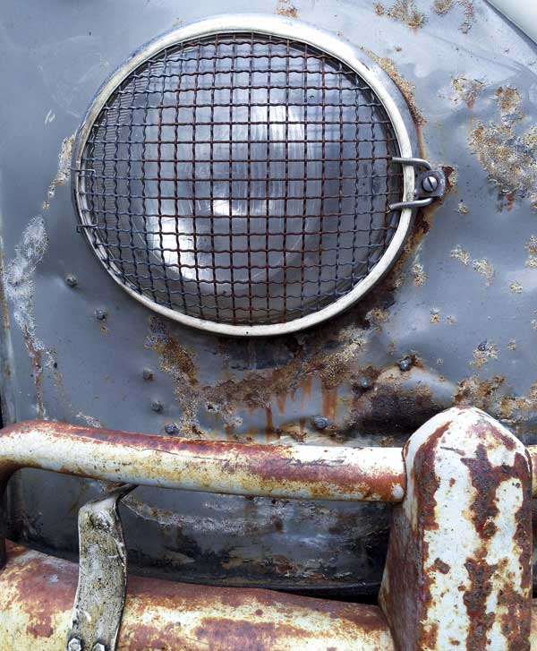 headlight detail from a beautiful battle scarred sub hatch Westfalia camper