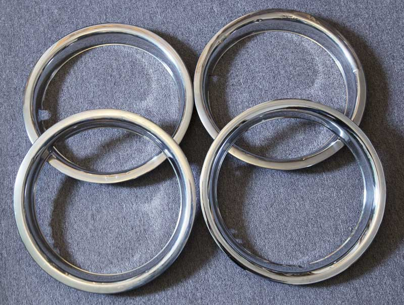 """set of of four 14"""" beauty rings in decent usable condition"""