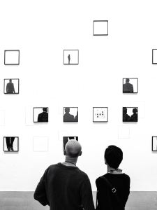 People looking a photos in a gallery