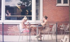 People who adjust as an expat in Essex county can spend time drinking coffee like these two women.