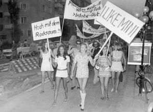 Women in Munich demonstrate against the 'maxi' looks featured in the approaching autumn and winter fashion in 1970.