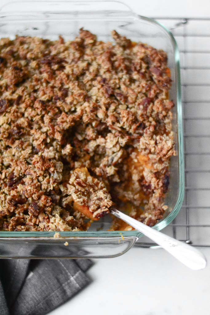 This indulgent Sweet Potato Casserole is incredibly healthy and delicious! Save this vegan sweet potato casserole recipe now because you're going to want to make it more than once! #veganrecipes #veganfood #sweetpotatoes #sweetpotatocasserole