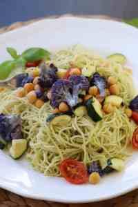 Pesto Pasta with Purple Cauliflower, Chickpeas, Grape tomatoes, and Zucchini https://www.veganblueberry.com