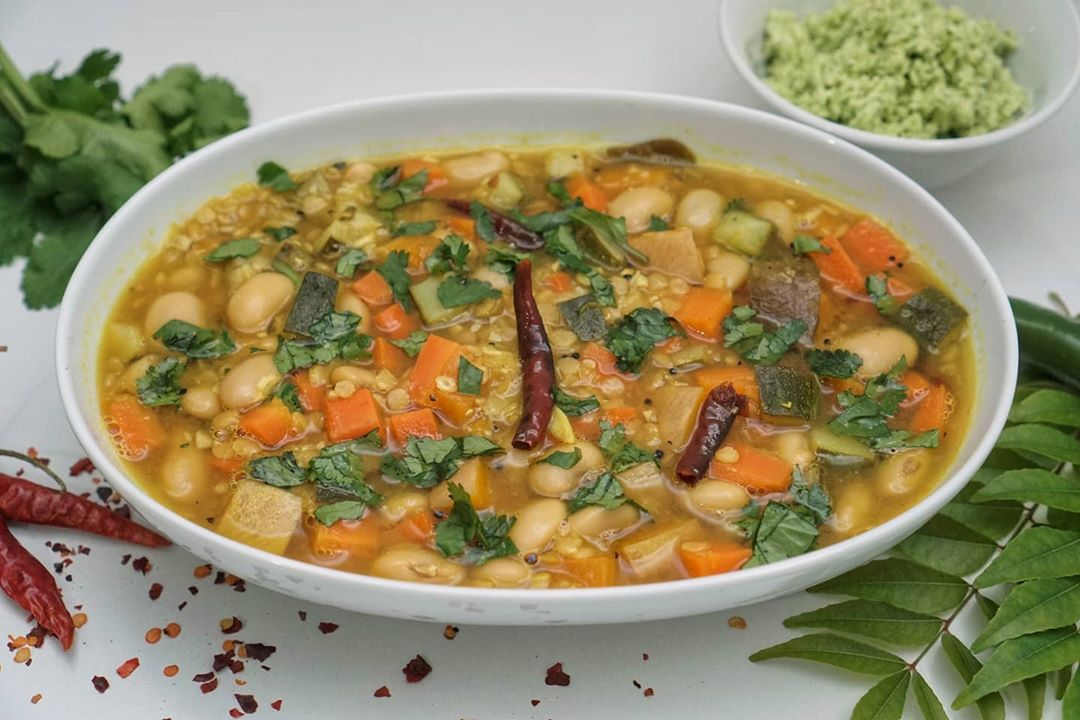 a warm veggie stew with bread roti  perfect for cold w display image  280d358a