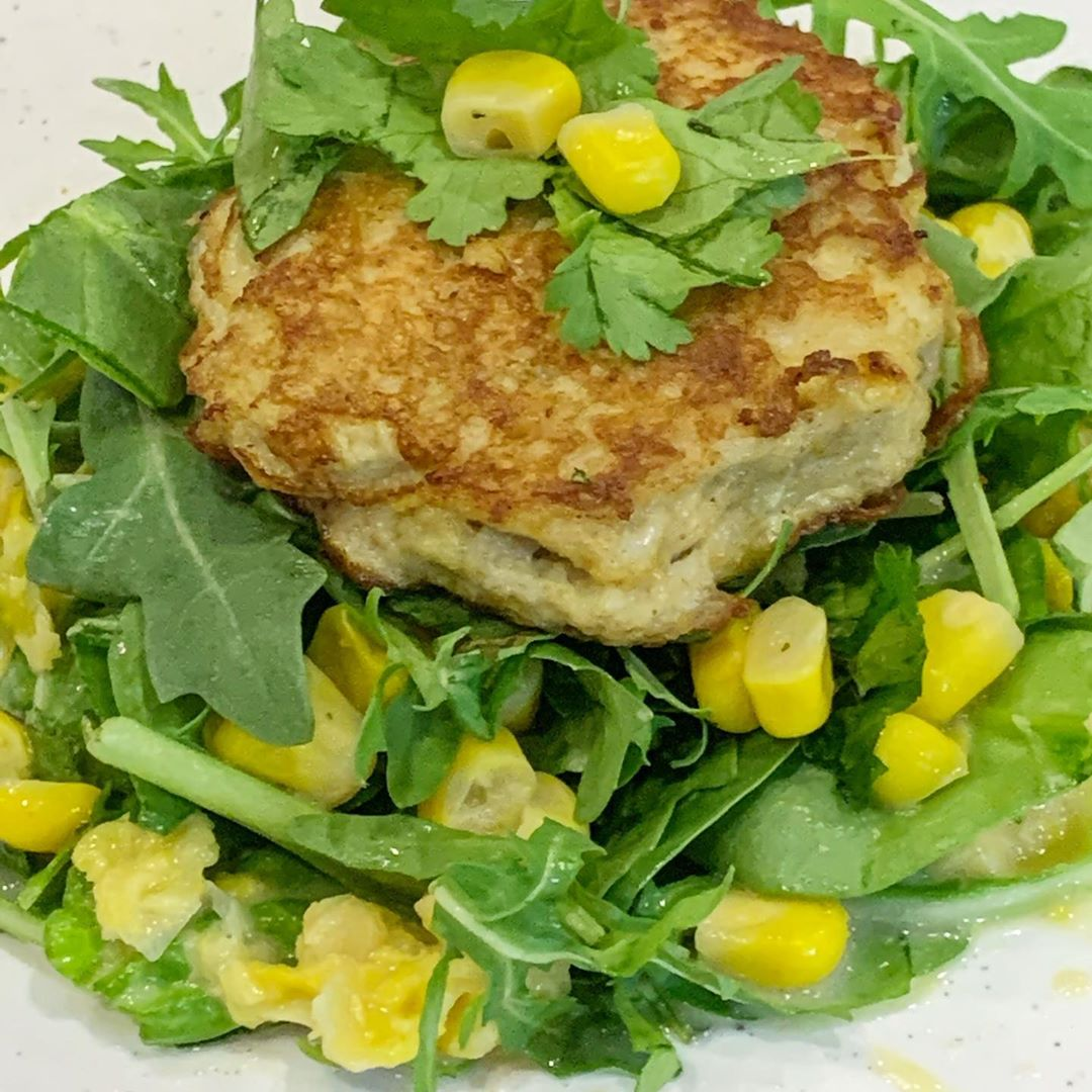 crab cake with spinach and arugula salad with creamed corn display image  6f1621bb