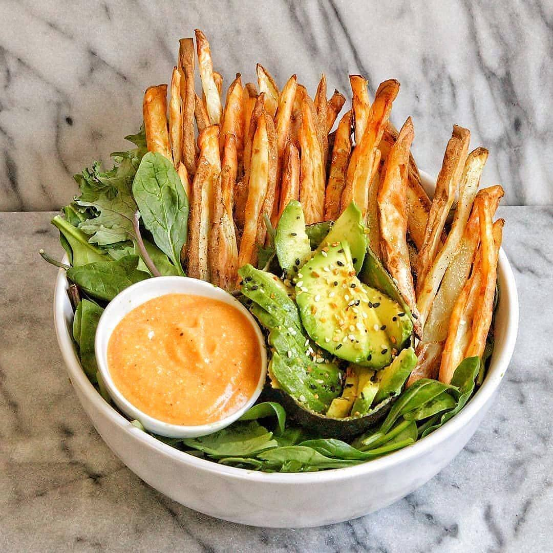 crispy fries with mixed greens nacho cheese sauce by vegan display image  d965452c