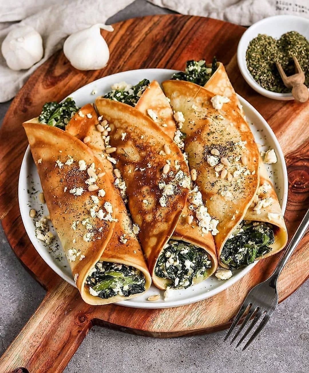 vegan oven baked filled crepes with spinach and feta display image be
