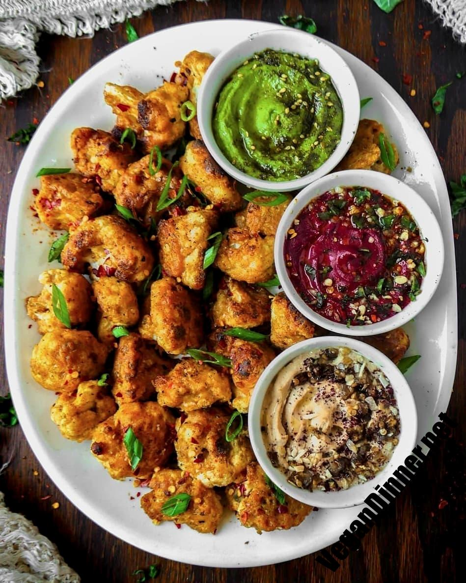 cauliflower wings with spicy beet pesto cannellini bean gre display image feb