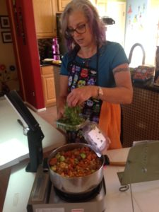 Adding cilantro to the stew