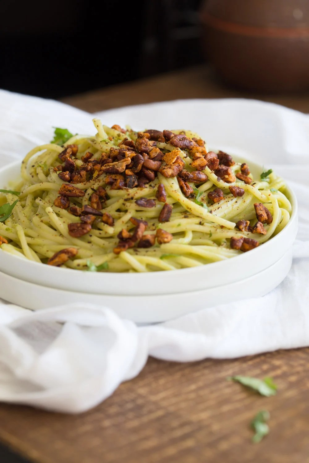 Avocado Pasta with Smoky Pecans. This 20 Minute Creamy Avocado Basil Sauce is great over spaghetti or zoodles. Serve with smoky spicy pecans for amazing flavor. #Vegan #Soyfree #Recipe. Can be #nutfree.#veganricha | VeganRicha.com