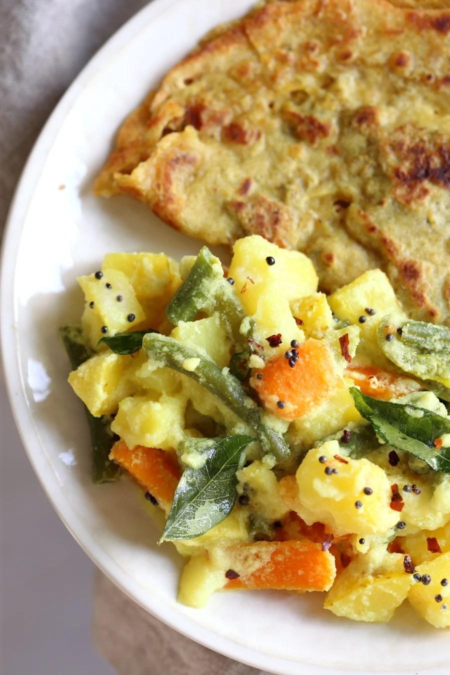 Avial - South Indian Veggie Coconut Curry. Seasonal Vegetables in easy spiced coconut sauce. Serve over rice, flatbread or dosa crepes. #Vegan #Indian #Glutenfree #Soyfree #Recipe #VeganRicha   VeganRicha.com