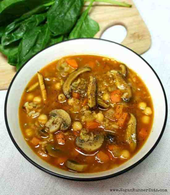 Vegan mushroom soup with chickpeas, barley and spinach